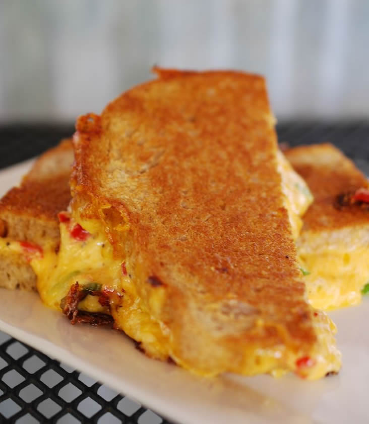 An ooey gooey grilled pimento cheese sandwich at Hubba Hubba Smokehouse