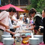 Guests make their way through a buffet at an on-site catering event at Hubba Hubba Smokehouse