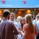 Guests mix and mingle under the stars at a catered event at Hubba Hubba Smokehouse