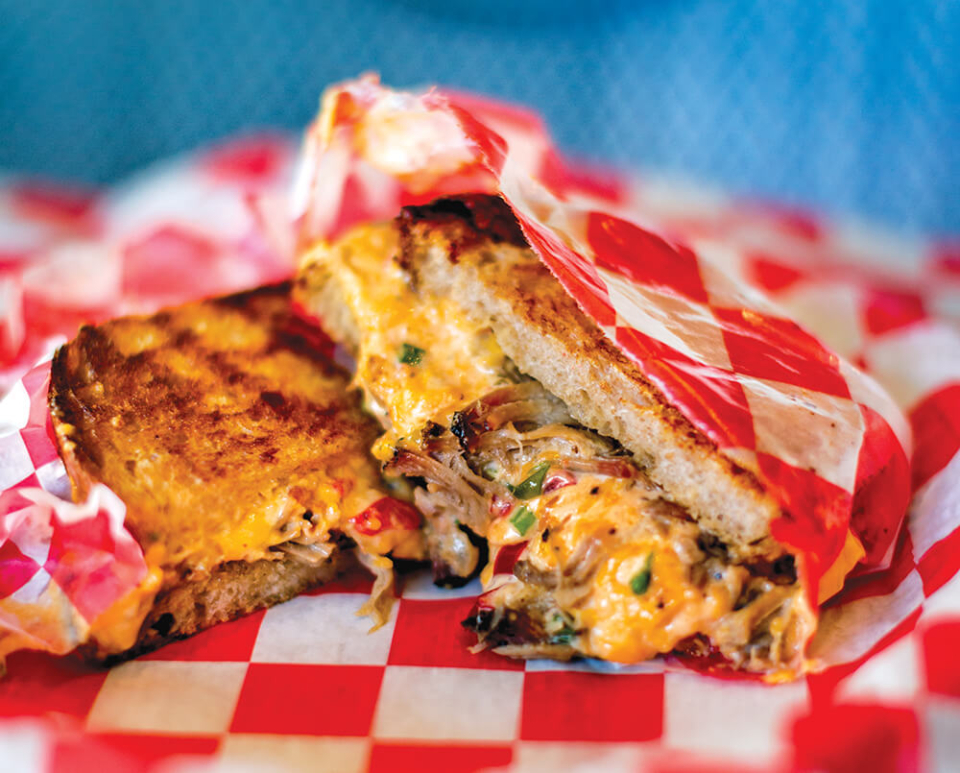 Mouth watering photo of grilled pimento cheese and pulled pork sandwich